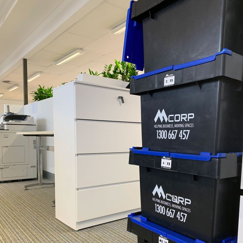 Mcorp crates next to filing cabinet